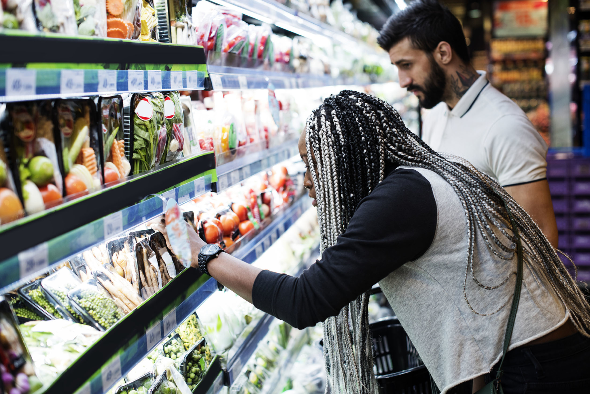 A couple shopping for food